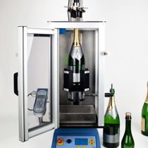Champagne cork extractor and torque measurement system